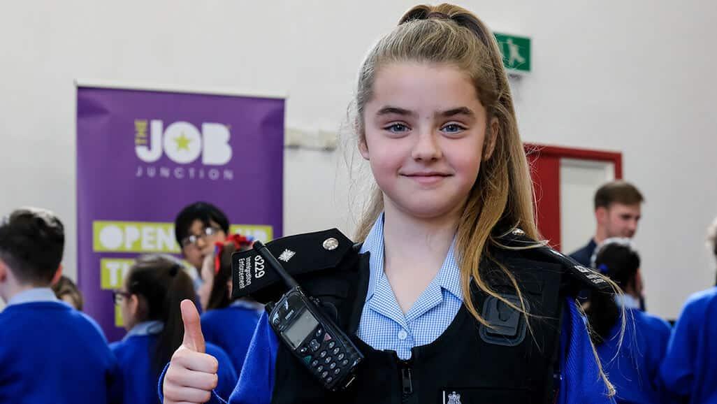 Photo of a child wearing immigration enforcement vest