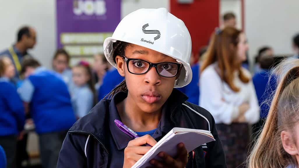 Photo of a child wearing a sovini hardhat