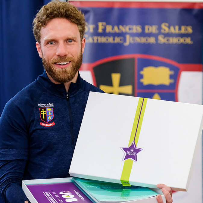 Thumbnail photo of a teacher holding our personal development programmes