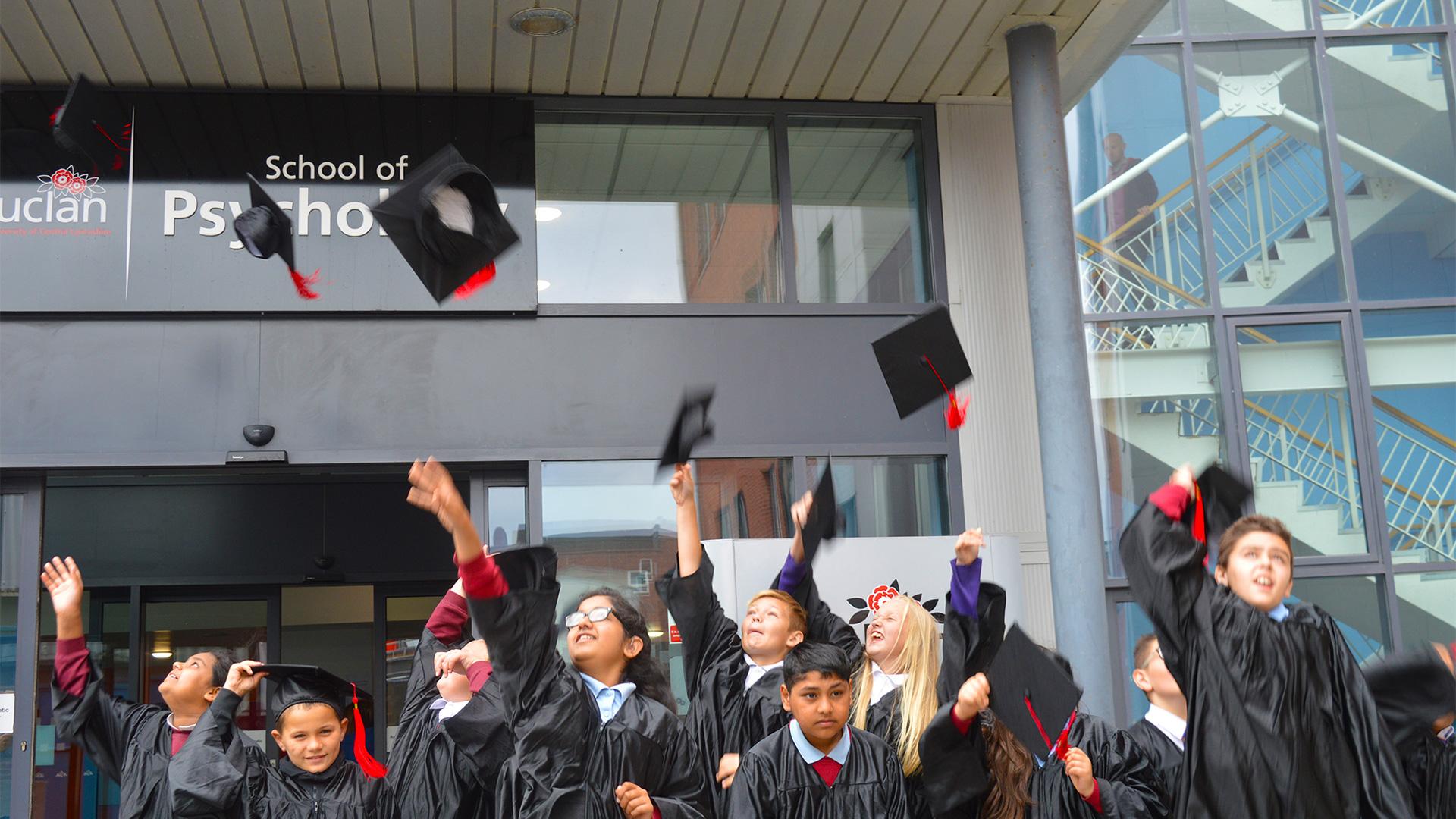 children celebrating graduating from the raising aspiration programme
