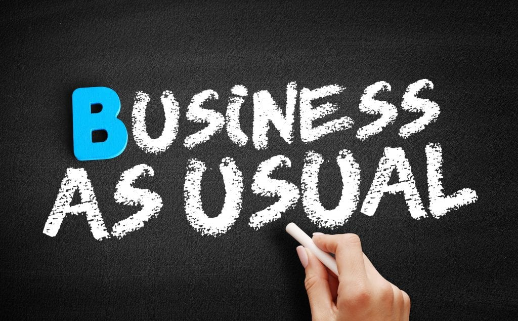Image of a writing saying 'business as usual
