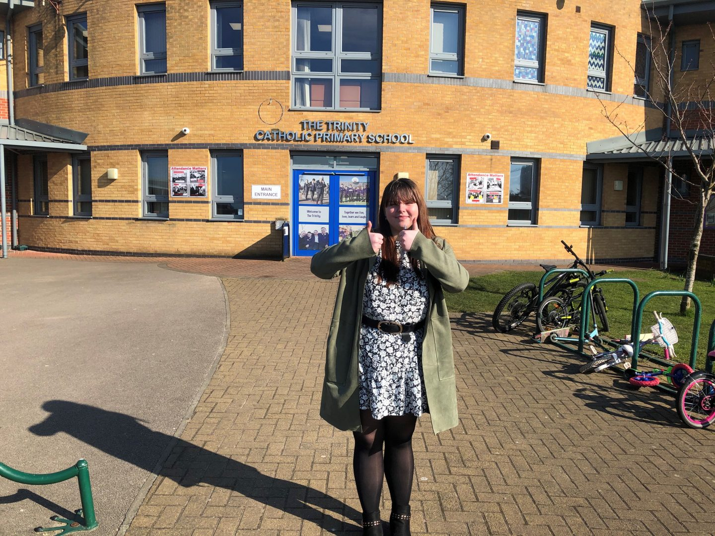 Photo of Positive Footprints apprentice Kate outside her out school