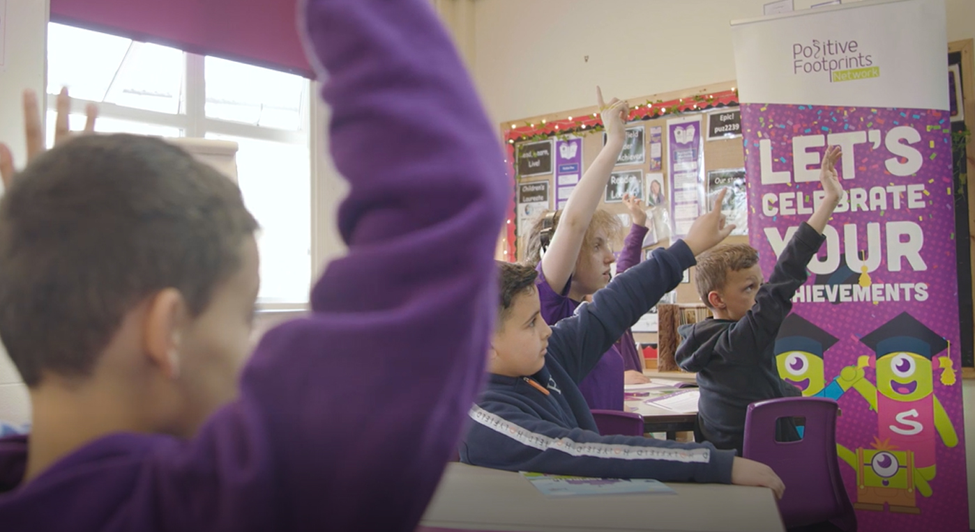 School children with their hand up during Raising Aspirations programme Halton Housing and Positive Footprints